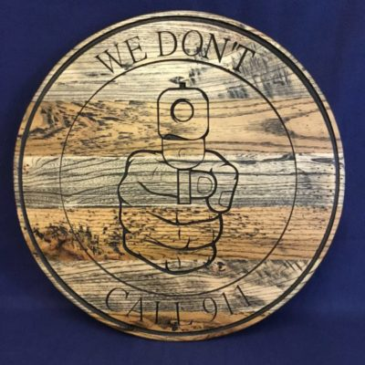 """We don't call 911"" round wooden sign"