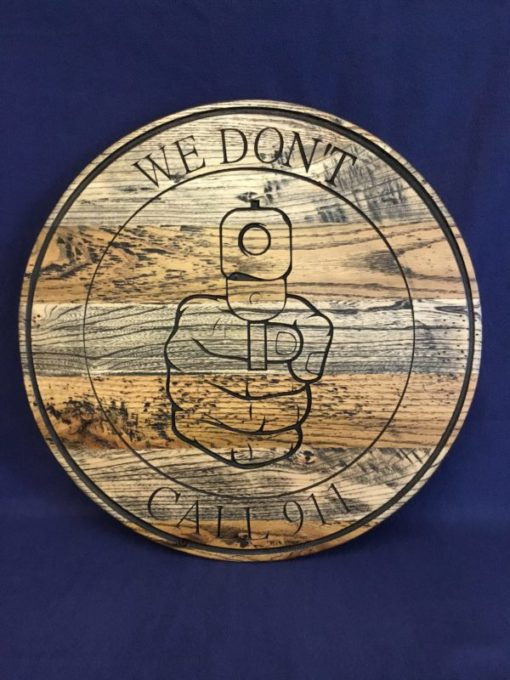 """""""We don't call 911"""" round wooden sign"""